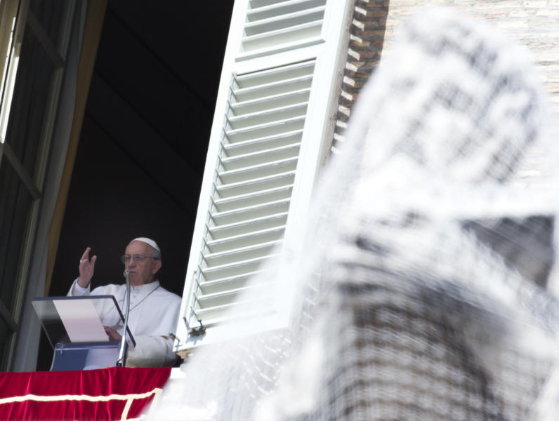 Pope Francis delivers his blessing during the Regina Coeli prayer from the window of his studio overlooking St. Peter's Square at the Vatican, Sunday, April 7, 2013. (AP Photo/Alessandra Tarantino)