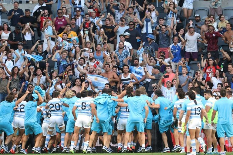 Argentina's players celebrate with fans after beating the All Blacks
