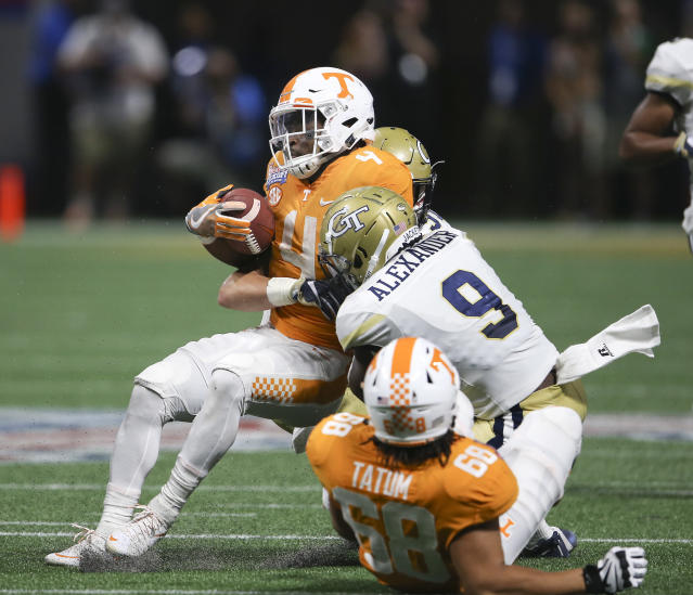"Tennessee running back <a class=""link rapid-noclick-resp"" href=""/ncaaf/players/263338/"" data-ylk=""slk:John Kelly"">John Kelly</a> (4) is stopped by Georgia Tech linebacker <a class=""link rapid-noclick-resp"" href=""/ncaaf/players/254411/"" data-ylk=""slk:Victor Alexander"">Victor Alexander</a> (9) in the first half of an NCAA college football game, Monday, Sept. 4, 2017, in Atlanta. (AP Photo/John Bazemore)"