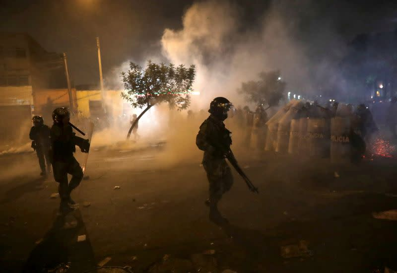 FILE PHOTO: Demonstrators clash with police during protests following the impeachment of President Martin Vizcarra, in Lima