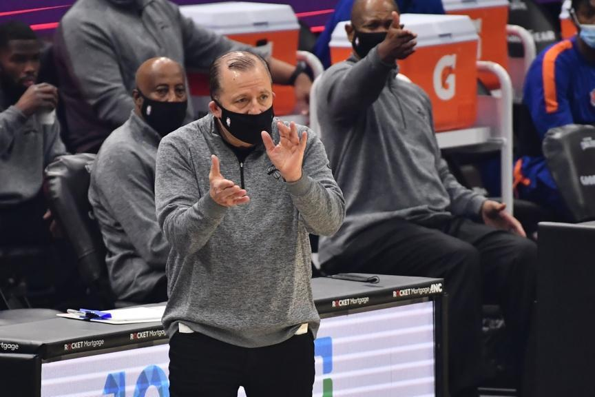 Tom Thibodeau encourages the team from the sideline while wearing mask
