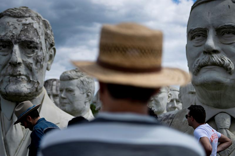 People look at the decaying remains of salvaged busts of former US Presidents during a tour by John Plashal August 25, 2019, in Williamsburg, Virginia. (Photo: Brendan Smialowski/AFP/Getty Images)