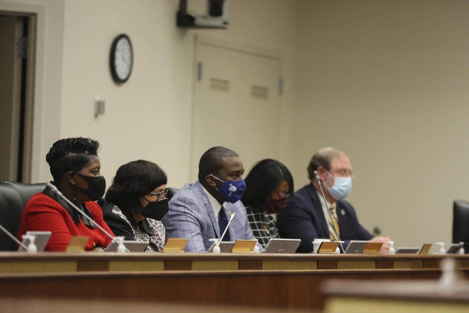 Several African American lawmakers listen as a House subcommittee hears testimony about a bill to define hate crimes in South Carolina on Tuesday, March 9, 2021, in Columbia, S.C. Forty-seven other states have a hate crimes bill. (AP Photo/Jeffrey Collins)