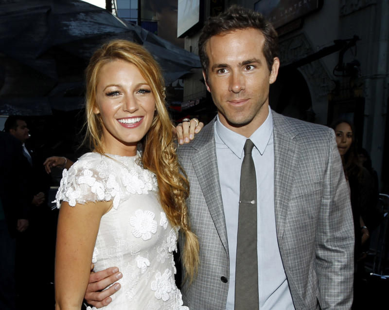 """FILE - This June 15, 2011 file photo shows actors Blake Lively, left, and Ryan Reynolds at the premiere of """"Green Lantern"""" in Los Angeles. Reynolds wed Blake Lively in Mount Pleasant, S.C.,  Sunday, Sept. 9, 2012, at Boone Hall Plantation, according to a person familiar with the ceremony who requested anonymity because they were not authorized to speak on the matter. While it's Lively's first marriage, Reynolds was previously married to Scarlett Johansson. Their divorce was finalized last summer after three years of marriage. Lively and Reynolds both starred in last year's """"Green Lantern."""" (AP Photo/Matt Sayles, file)"""