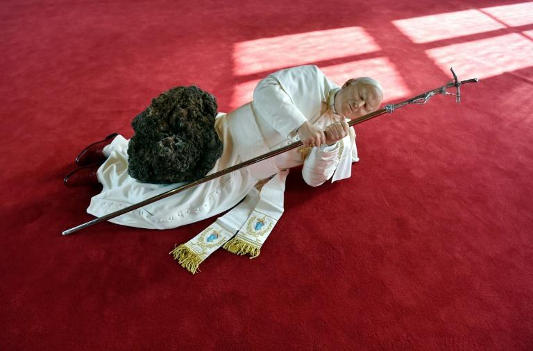 Italian artist Maurizio Cattelan's wax statue shown at the 1999 Venice Biennale depicted the pope -- then living -- being crushed by a meteor