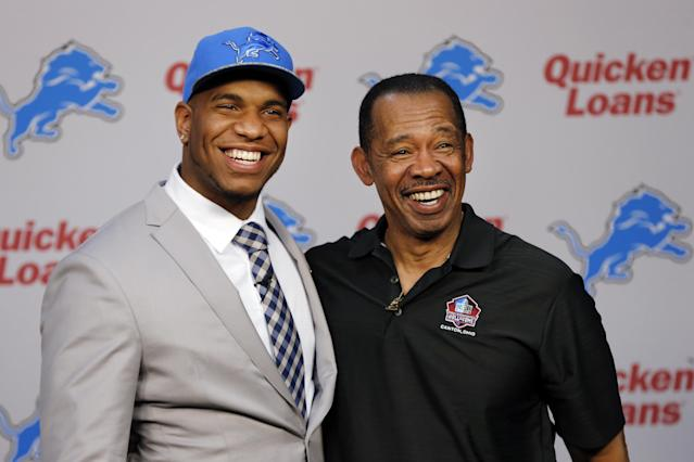 Detroit Lions NFL football first round draft choice, 10th overall, North Carolina tight end Eric Ebron, left, poses with Hall of Fame tight end Charlie Sanders during an NFL football news conference in Allen Park, Mich., Friday, May 9, 2014. (AP Photo/Paul Sancya)