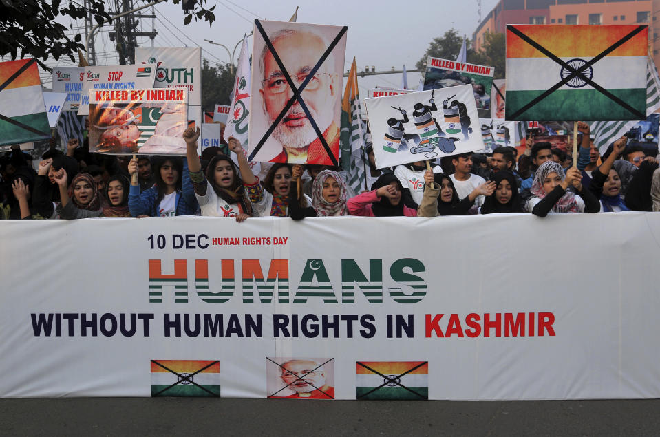 Members of Youth Forum for Kashmir chant anti India slogans during a demonstration to mark International Human Rights Day, in Lahore, Pakistan, Tuesday, Dec. 10, 2019. Protesters chanted slogans against the Indian government to condemn violence against Indian Kashmiris who are resisting Indian rule. (AP Photo/K.M. Chaudary)