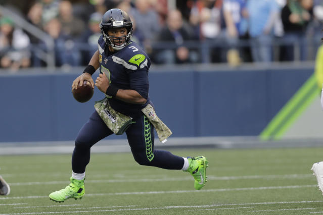 Seattle Seahawks quarterback Russell Wilson scrambles against the Tampa Bay Buccaneers during the second half of an NFL football game, Sunday, Nov. 3, 2019, in Seattle. (AP Photo/John Froschauer)