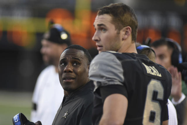 Vanderbilt Head Coach Derek Mason, left, talks with quarterback Riley Neal (6) in the second half of an NCAA college football game against UNLV, Saturday, Oct. 12, 2019, in Nashville, Tenn. (AP Photo/Mike Strasinger)