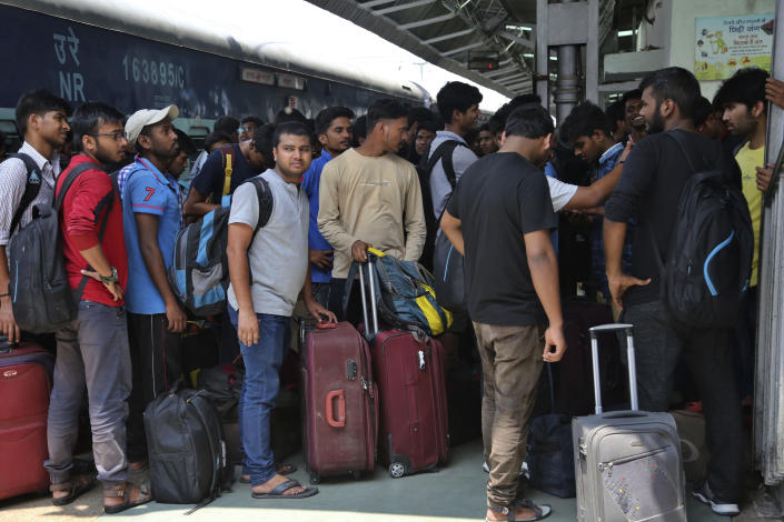 """National Institute of Technology (NIT) students who left Srinagar, Kashmir's main city wait to leave for their respective homes at the railway station in Jammu, India, Sunday, Aug. 4, 2019. Thousands of Indian students and visitors were fleeing Indian-controlled Kashmir over the weekend after the government ordered tourists and Hindu pilgrims visiting a Himalayan cave shrine """"to curtail their stay"""" in the disputed territory, citing security concerns. (AP Photo/Channi Anand)"""