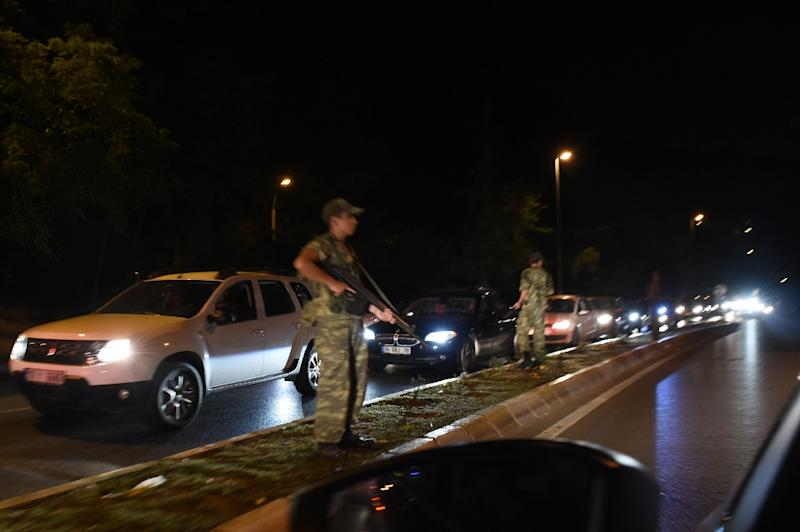 A Turkish security officers stands on guard on the side of the road on July 15, 2016 in Istanbul, during a security shutdown of the Bosphorus Bridge