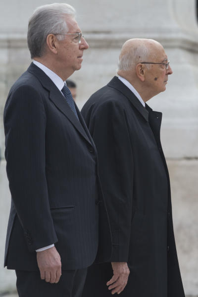 Italian President Giorgio Napolitano, right, and Premier Mario Monti leave after they paid homage to the Unknown Soldier Monument in Rome, Monday, April 22, 2013. President Giorgio Napolitano headed Monday into his unprecedented second term with the daunting task of trying to find a candidate who can form a government two months after national elections left Italy with no clear winner and an increasingly discredited political class. (AP Photo/Andrew Medichini)