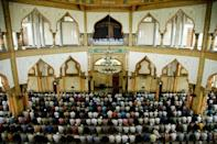 Mosques were jammed across virus-wracked Indonesia on Friday