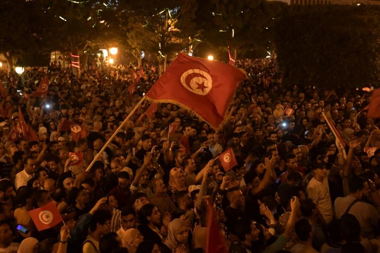 Thousands of people took to the streets of the capital Tunis to celebrate Saied's victory, honking horns and singing the national anthem (AFP Photo/Fethi Belaid)