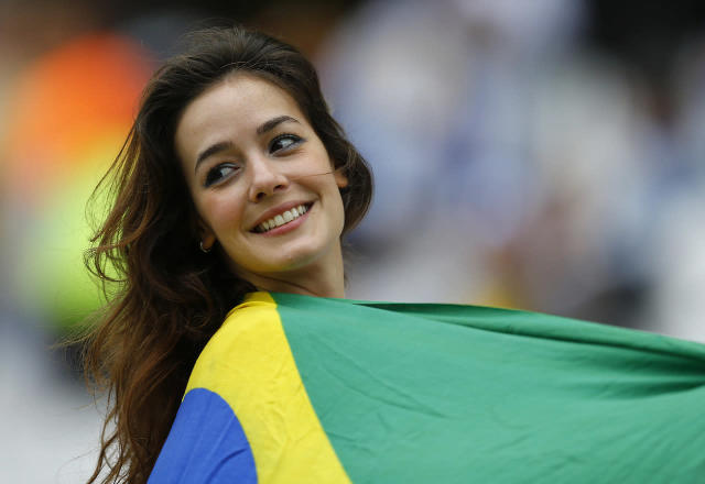 A fan waits for the 2014 World Cup Group D soccer match between Uruguay and England at the Corinthians arena in Sao Paulo June 19, 2014. (REUTERS/Ivan Alvarado)
