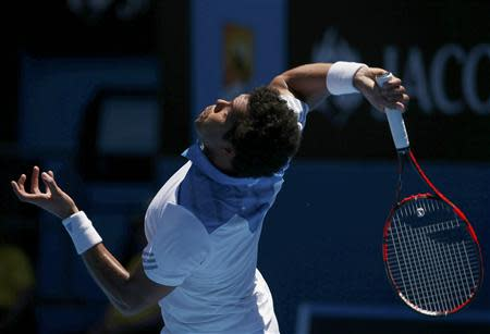 Jo-Wilfried Tsonga of France serves during his men's singles match against Filippo Volandri of Italy at the Australian Open 2014 tennis tournament in Melbourne January 14, 2014. REUTERS/David Gray