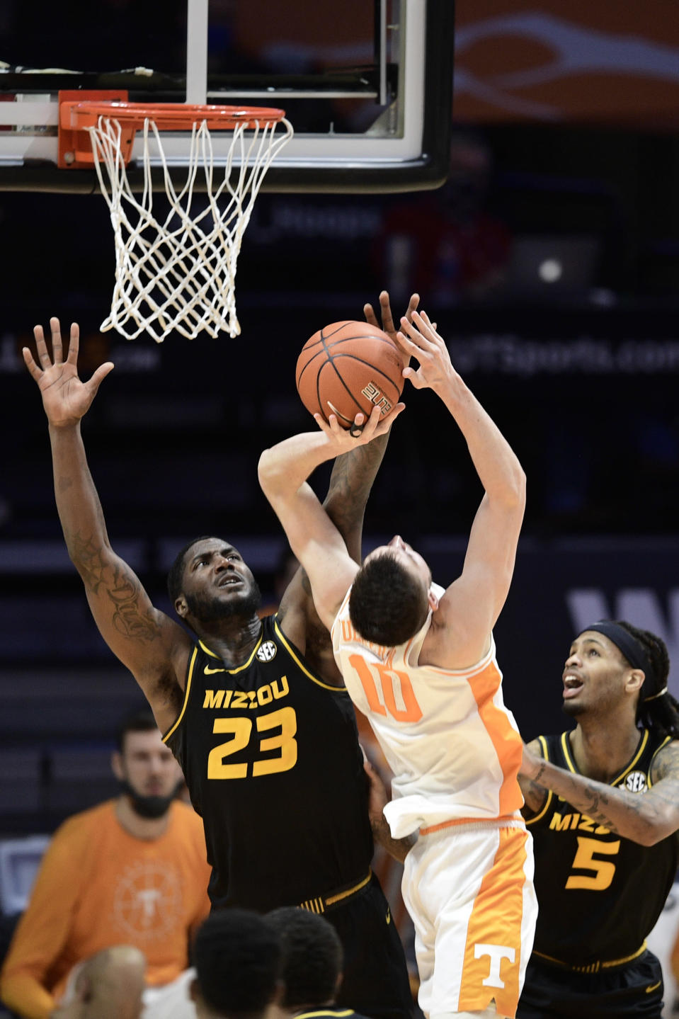 Missouri forward Jeremiah Tilmon (23) defends against Tennessee forward John Fulkerson (10) during an NCAA college basketball game Saturday, Jan. 23, 2021, in Knoxville, Tenn. (Calvin Mattheis/Knoxville New-Sentinel via AP, pool)