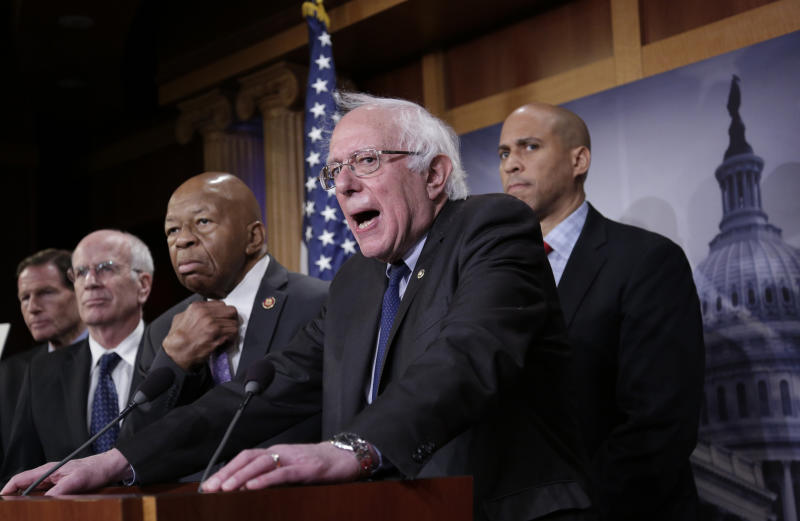 """Sen. Bernie Sanders, I-Vt., center, joined from left by Sen. Richard Blumenthal, D-Conn., Rep. Peter Welch, D-Vt., Rep. Elijah Cummings, D-Md., and Sen. Cory Booker, D-N.J., speaks to reporters as he prepares to introduce new legislation that aims to reduce what Americans pay for prescription drugs, especially brand-name drugs deemed """"excessively priced,"""" during a news conference on Capitol Hill in Washington, Thursday, Jan. 10, 2019. (AP Photo/J. Scott Applewhite)"""