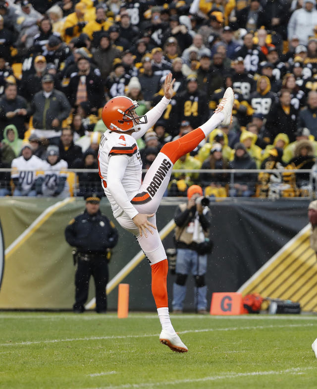 FILE - In this Oct. 28, 2018, file photo, Cleveland Browns punter Britton Colquitt kicks against the Pittsburgh Steelers during an NFL football game in Pittsburgh. The Minnesota Vikings have yet another new specialist, veteran punter Britton Colquitt, after making the swap for Matt Wile. (AP Photo/Winslow Townson, File)