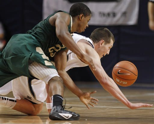 UAB guard Quincy Taylor (25) and Rice forward Lucas Kuipers dive after a loose ball during the second half of an NCAA college basketball game Wednesday, Jan. 18, 2012, in Houston. UAB beat Rice 61-60 in overtime. (AP Photo/Houston Chronicle, Brett Coomer) MANDATORY CREDIT