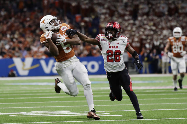 Texas WR Devin Duvernay caught three passes for 92 yards and a TD in the Alamo Bowl win over Utah. (AP Photo/Eric Gay)