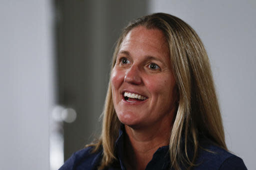 FILE - In this Oct. 3, 2019, file photo, North Carolina women's NCAA college basketball coach Courtney Banghart answers a question during the Atlantic Coast Conference media day in Charlotte, N.C. Banghart is taking over a North Carolina program in need of an overhaul on and off the court. (AP Photo/Nell Redmond, File)