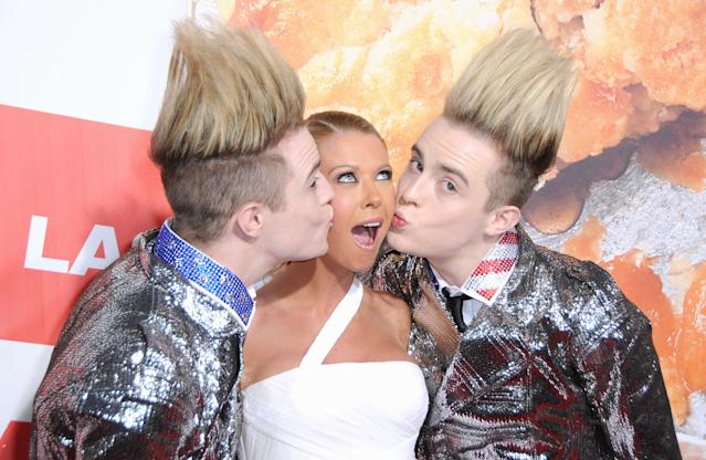 """Edward Grimes of Jedward, actress Tara Reid and John Grimes of Jedward arrive at the Los Angeles Premiere """"American Reunion"""" in 2012 (Barry King/FilmMagic)"""