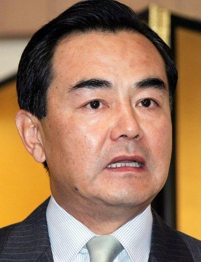 <p>This file picture taken on May 11, 2005, shows Wang Yi addressing the media in Tokyo. China's parliament has approved Wang -- a former ambassador to Japan -- as the country's new foreign minister with tensions high between the two Asian giants over disputed islands.</p>