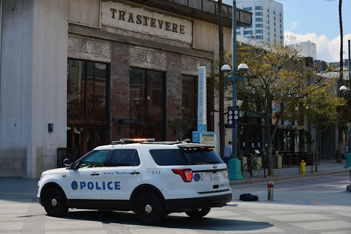 Santa Monica police out on patrol on March 29 at Third Street Promenade. Retail stores are closed due to COVID-19 pandemic.