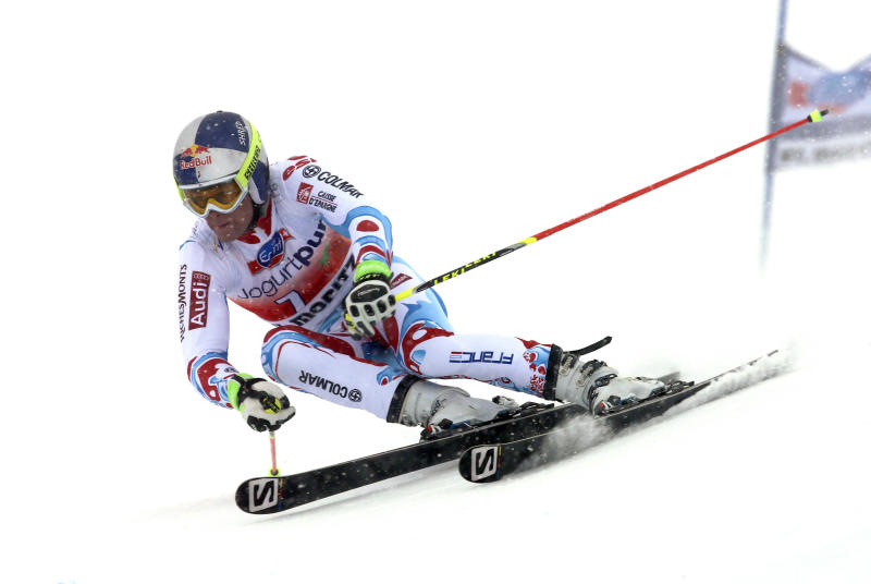 France's Alexis Pinturault speeds down the course during the first run of an alpine ski men's World Cup giant slalom in St. Moritz, , Switzerland, Sunday, Feb. 2, 2014. (AP Photo/Pier Marco Tacca)