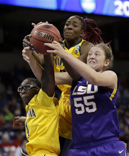 LSU's Theresa Plaisance (55) battles California's Avigiel Cohen, left, and Gennifer Brandon for a loose ball in the second half of a regional semifinal game in the NCAA women's college basketball tournament Saturday, March 30, 2013, in Spokane, Wash. (AP Photo/Elaine Thompson)