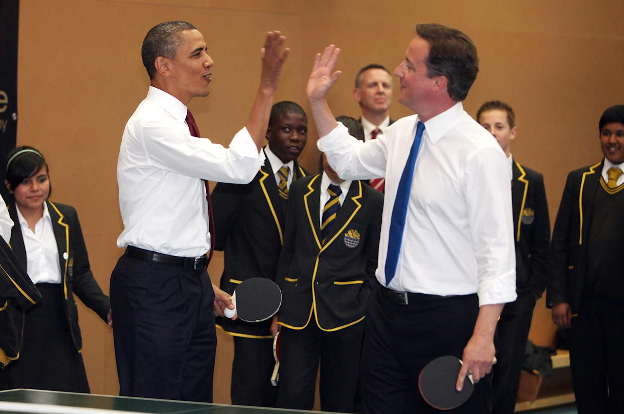 LONDON, ENGLAND - MAY 24:  U.S. President Barack Obama and British Prime Minister David Cameron (R) play table tennis at Globe Academy on May 24, 2011 in London, England. The 44th President of the United States, Barack Obama, and his wife Michelle are in the UK for a two day State Visit at the invitation of HM Queen Elizabeth II. During the trip they will attend a state banquet at Buckingham Palace and the President will address both houses of parliament at Westminster Hall.  (Photo by Richard Pohle - WPA Pool/Getty Images)