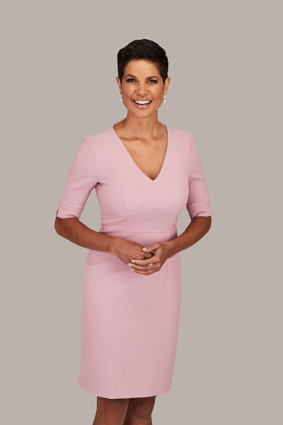 Narelda Jacobs poses in an official photo for Channel 10 wearing a pink dress