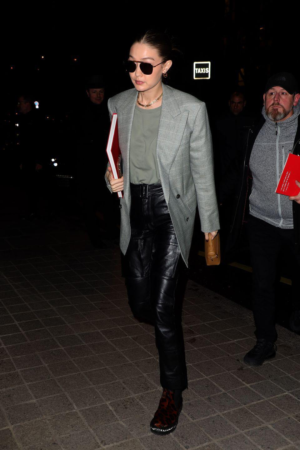 <p>Gigi's worn this outfit equation endless times (seriously, just keep scrolling), but somehow always makes it feel brand new. I think the secret here is those badass leopard boots, amiright?!</p>