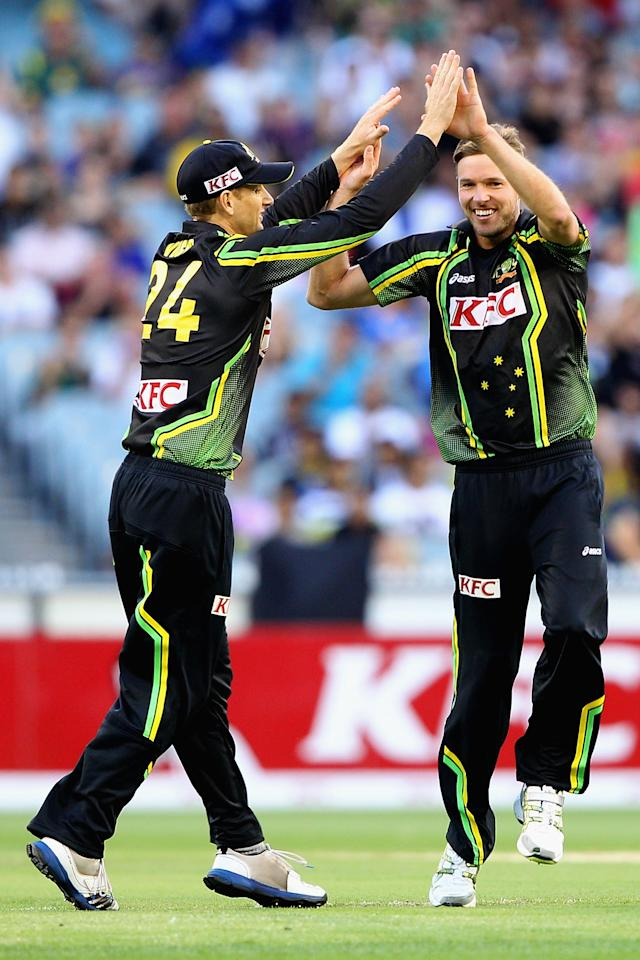 MELBOURNE, AUSTRALIA - JANUARY 28:  Ben Laughlin (R) of Australia celebrates the wicket of Dinesh Chandimal of Sri Lanka during game two of the Twenty20 International series between Australia and Sri Lanka at Melbourne Cricket Ground on January 28, 2013 in Melbourne, Australia.  (Photo by Robert Prezioso/Getty Images)
