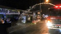 Indonesia uses fire engine water jets to enforce Covid-19 restrictions