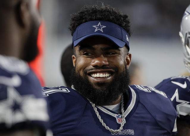 Ezekiel Elliott was suspended six games by the NFL in a domestic violence case. (AP)