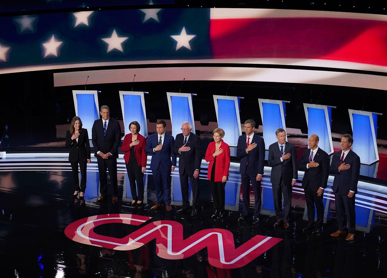 Candidates await their chance to spar before the start of the first night of the Democratic presidential debates at the Fox Theatre in Detroit on July 30.