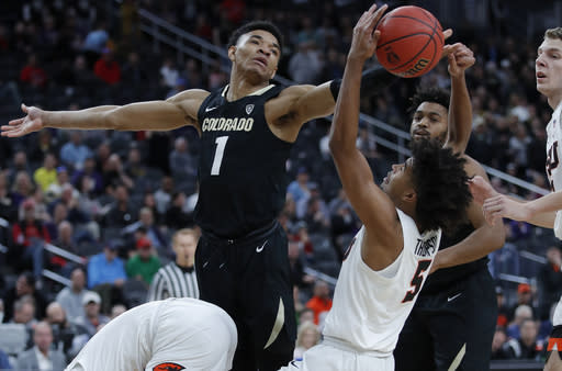 Colorado's Tyler Bey (1) vies for a rebound with Oregon State's Ethan Thompson (5) during the first half of an NCAA college basketball game in the quarterfinals of the Pac-12 men's tournament Thursday, March 14, 2019, in Las Vegas. (AP Photo/John Locher)