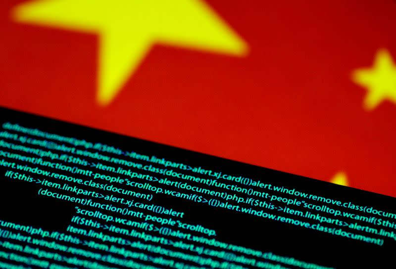 FILE PHOTO: Illustration photo of computer code on a screen above a Chinese flag