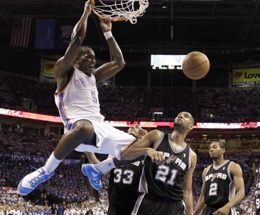 Oklahoma City Thunder center Kendrick Perkins (5) dunks in front of San Antonio Spurs' Tim Duncan (21), Boris Diaw (33), and Kawhi Leonard (2) during the first half of Game 4 in the NBA basketball playoffs Western Conference finals, Saturday, June 2, 2012, in Oklahoma City. (AP Photo/Eric Gay)