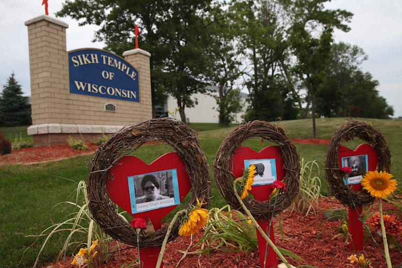 Pictures of victims of the shooting at the Sikh Temple of Wisconsin mark the one-year anniversary of the shooting rampage that killed six poeple, August 5, 2013 in Oak Creek, Wisconsin (AFP Photo/Scott Olson)