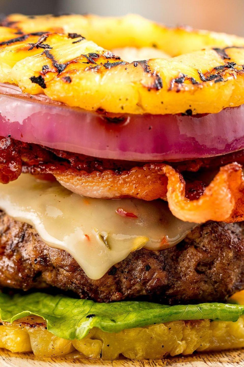 """<p><a href=""""https://www.delish.com/uk/cooking/recipes/a28924339/best-burger-recipe/"""" rel=""""nofollow noopener"""" target=""""_blank"""" data-ylk=""""slk:Burgers"""" class=""""link rapid-noclick-resp"""">Burgers</a> get a tropical — and low carb! — makeover when slices of charred pineapple replace the buns.</p><p>Get the <a href=""""https://www.delish.com/uk/cooking/recipes/a30312260/pineapple-bun-burgers-recipe/"""" rel=""""nofollow noopener"""" target=""""_blank"""" data-ylk=""""slk:Pineapple Bun Burger"""" class=""""link rapid-noclick-resp"""">Pineapple Bun Burger</a> recipe.</p>"""