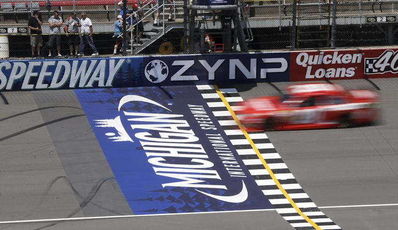Driver Matt Kenseth crosses the start/finish line during a practice session for Sunday's NASCAR Sprint Cup series auto race at Michigan International Speedway Friday, June 14, 2013, in Brooklyn, Mich. (AP Photo/Carlos Osorio)