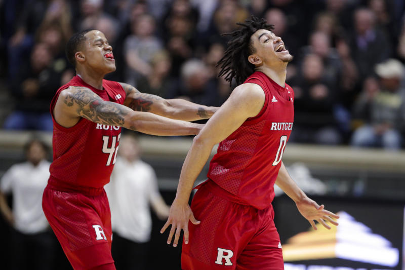 Rutgers guards Geo Baker (0) and Jacob Young (42) celebrate in the closing seconds of overtime in an NCAA college basketball game in West Lafayette, Ind., Saturday, March 7, 2020. Rutgers defeated Purdue 71-68 in overtime. (AP Photo/Michael Conroy)