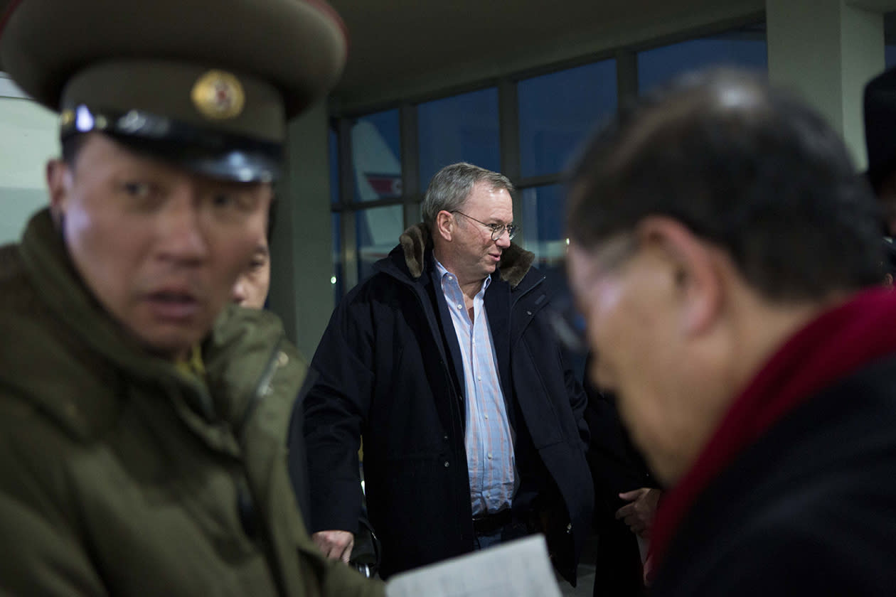 Executive Chairman of Google Eric Schmidt, center, arrives at Pyongyang International Airport in Pyongyang, North Korea.