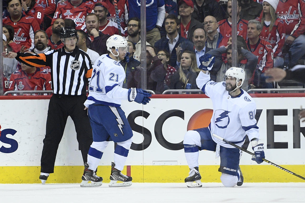Tampa Bay Lightning right wing Nikita Kucherov, right, of Russia, celebrates his goal with center Brayden Point (21) during the second period of an NHL hockey game against the Washington Capitals, Wednesday, March 20, 2019, in Washington. (AP Photo/Nick Wass)