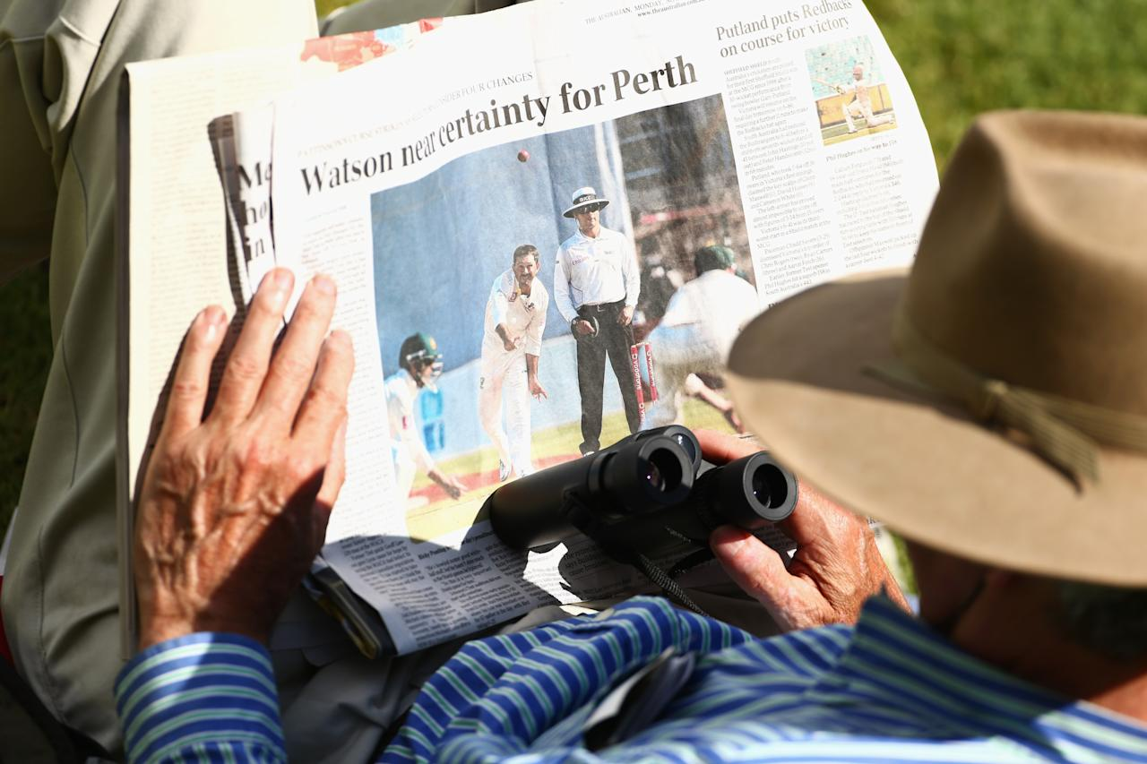 ADELAIDE, AUSTRALIA - NOVEMBER 26:  A spectator in the crowd reads the newspaper during day five of the Second Test Match between Australia and South Africa at Adelaide Oval on November 26, 2012 in Adelaide, Australia.  (Photo by Mark Kolbe/Getty Images)