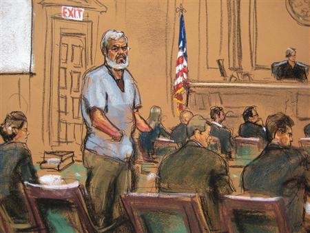 Abu Hamza al-Masri, the radical Islamist cleric facing U.S. terrorism charges, stands with his legal team in Manhattan federal court in New York