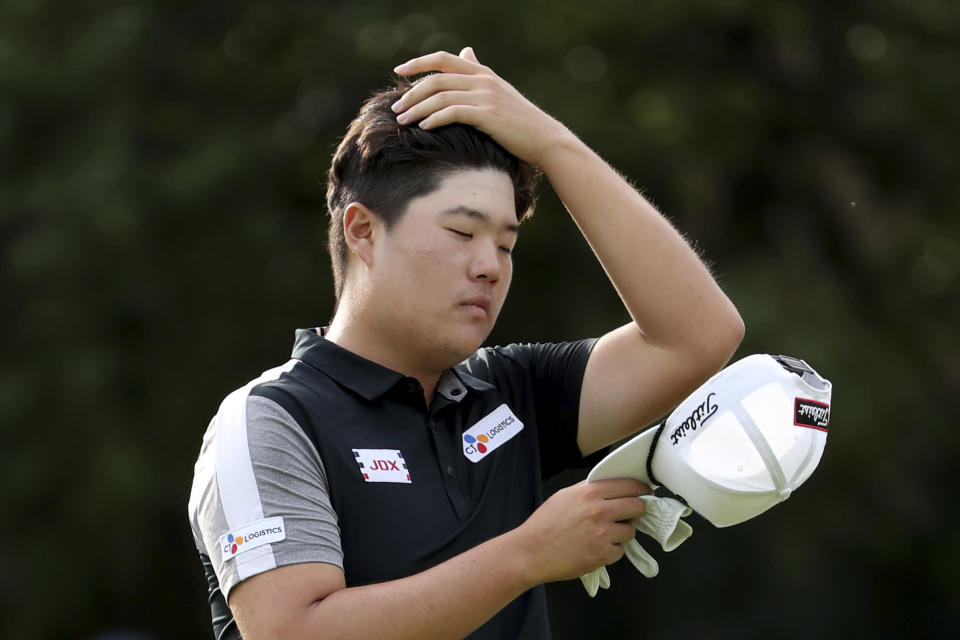 Sungjae Im of South Korea brushes back his hair during the HSBC Champions golf tournament held at the Sheshan International Golf Club in Shanghai on Friday, Nov. 1, 2019. (AP Photo/Ng Han Guan)